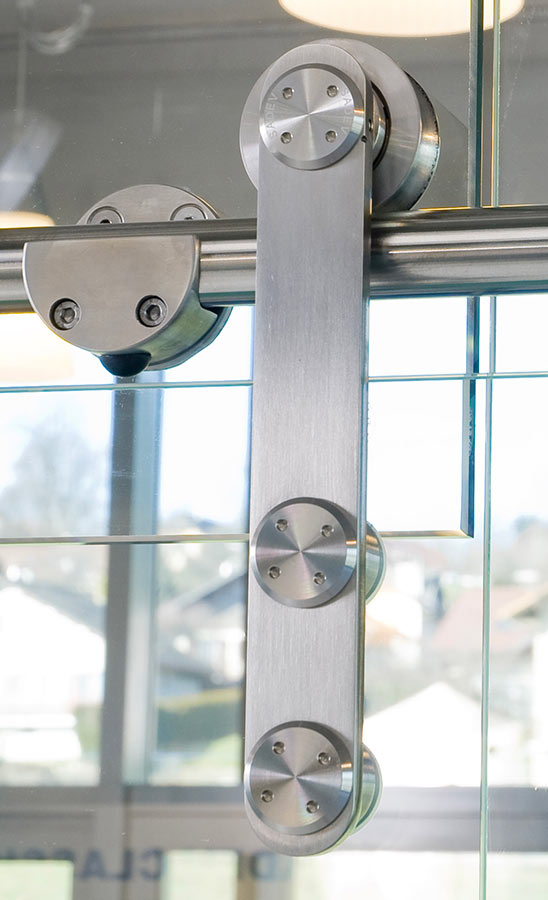 Stainless stell sliding system for glass doors - Residential, commercial applications
